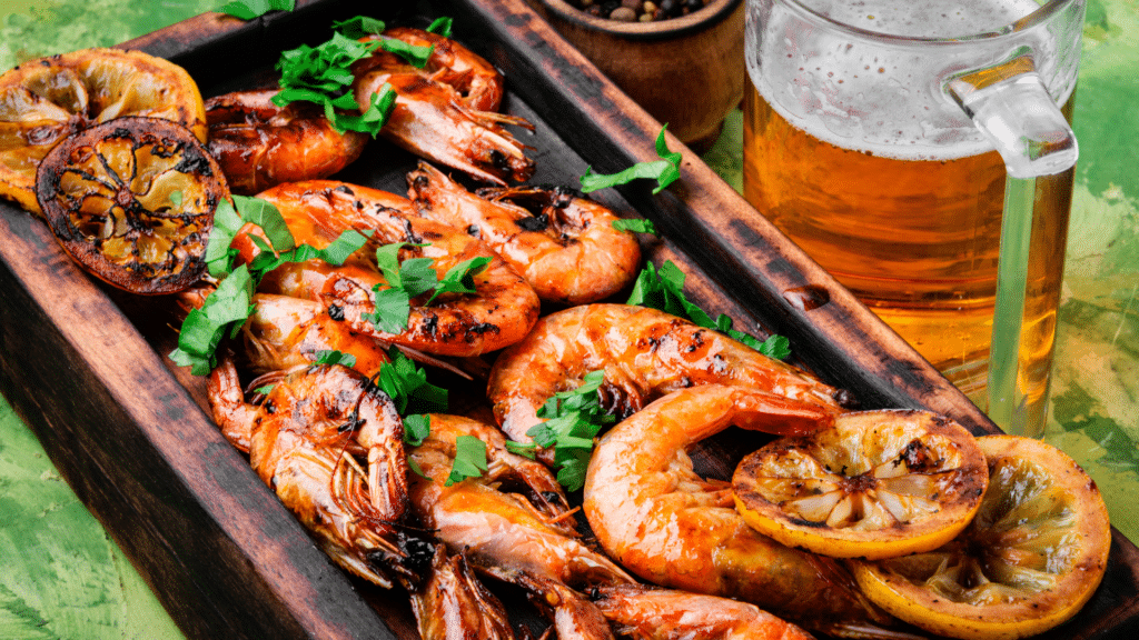 Platter of grilled prawns and beer